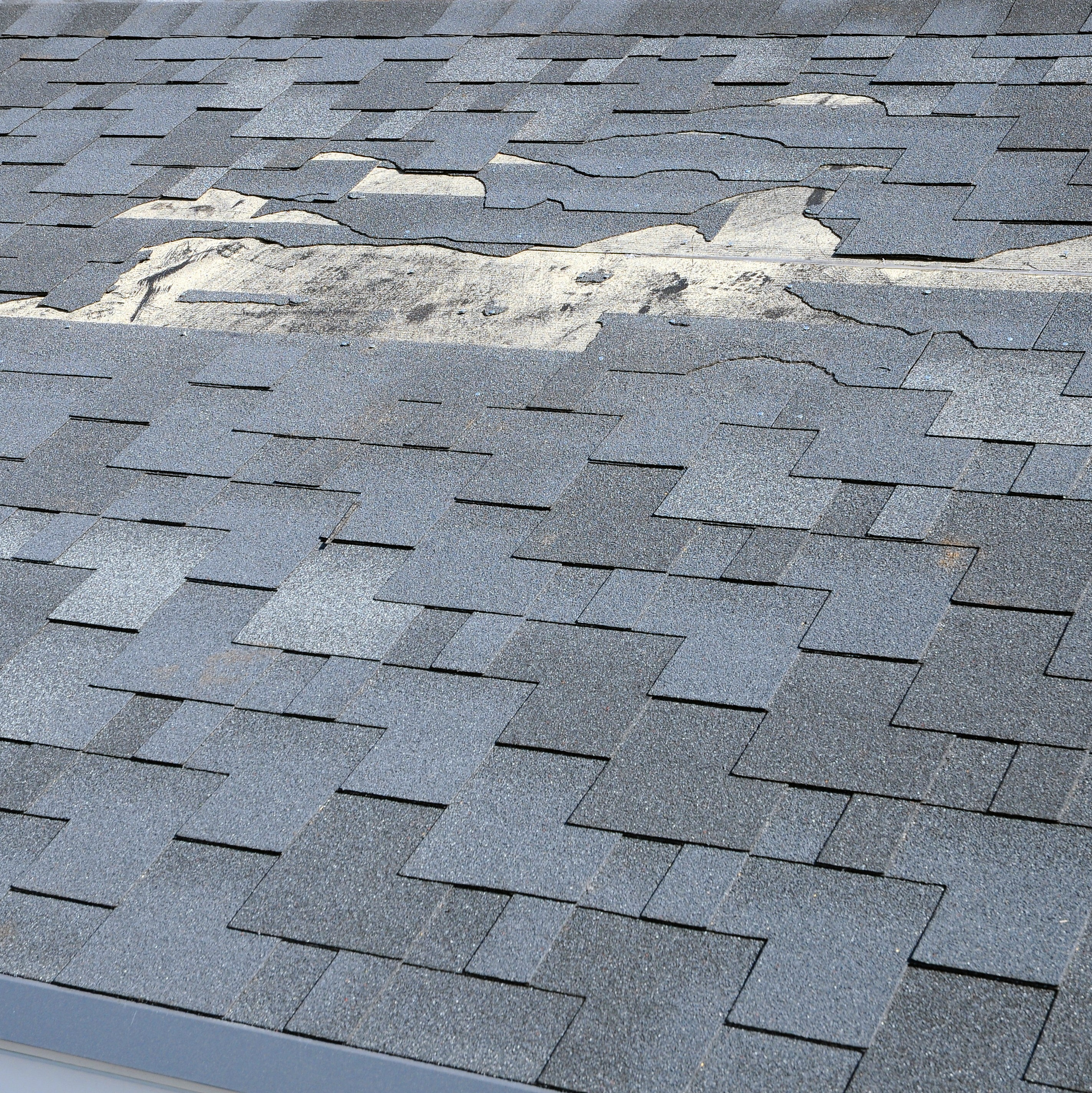 A section of damaged roof that needs to be repaired.