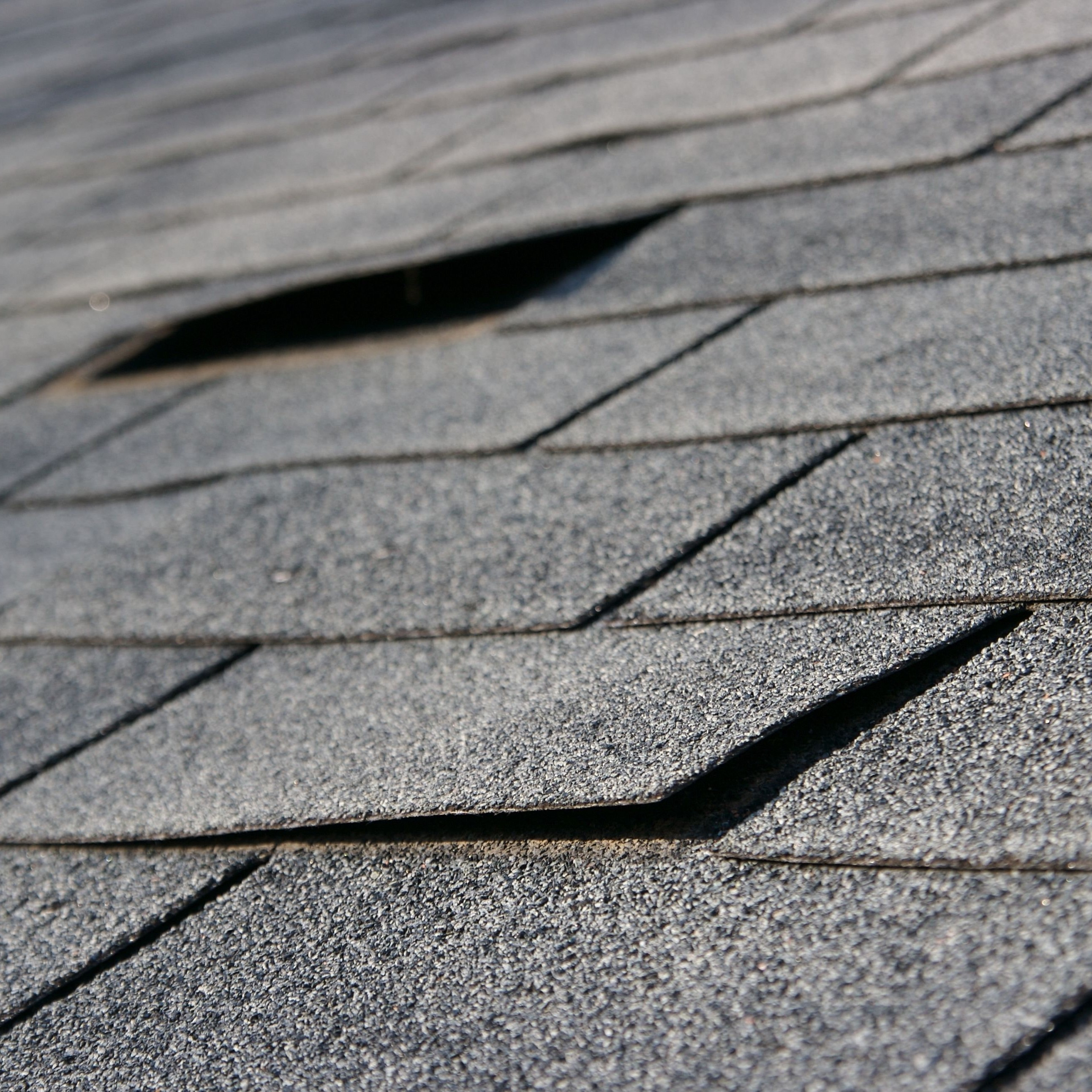 Asphalt shingles that need to be repaired so they function properly.