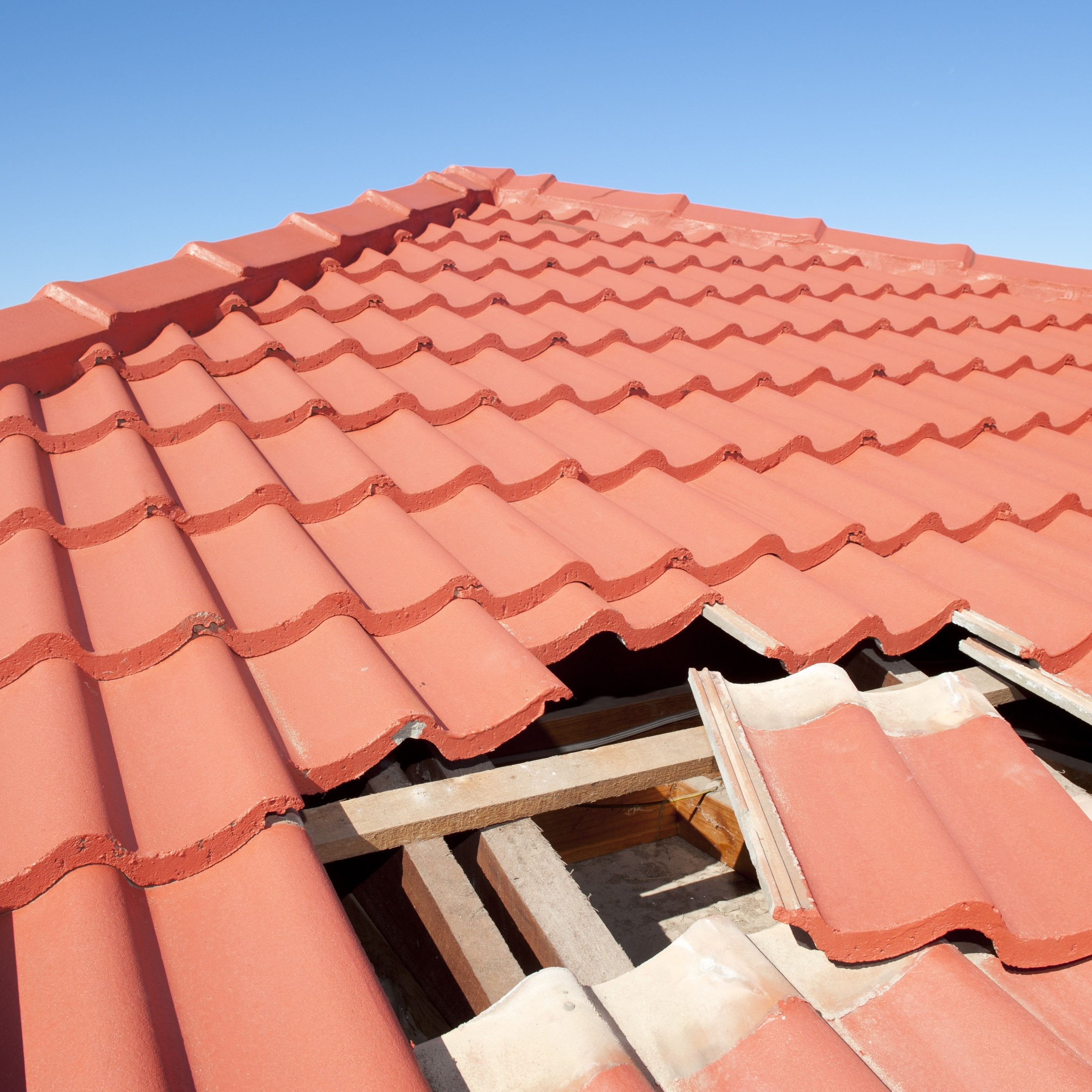 A tile roof that is in need of repairs.