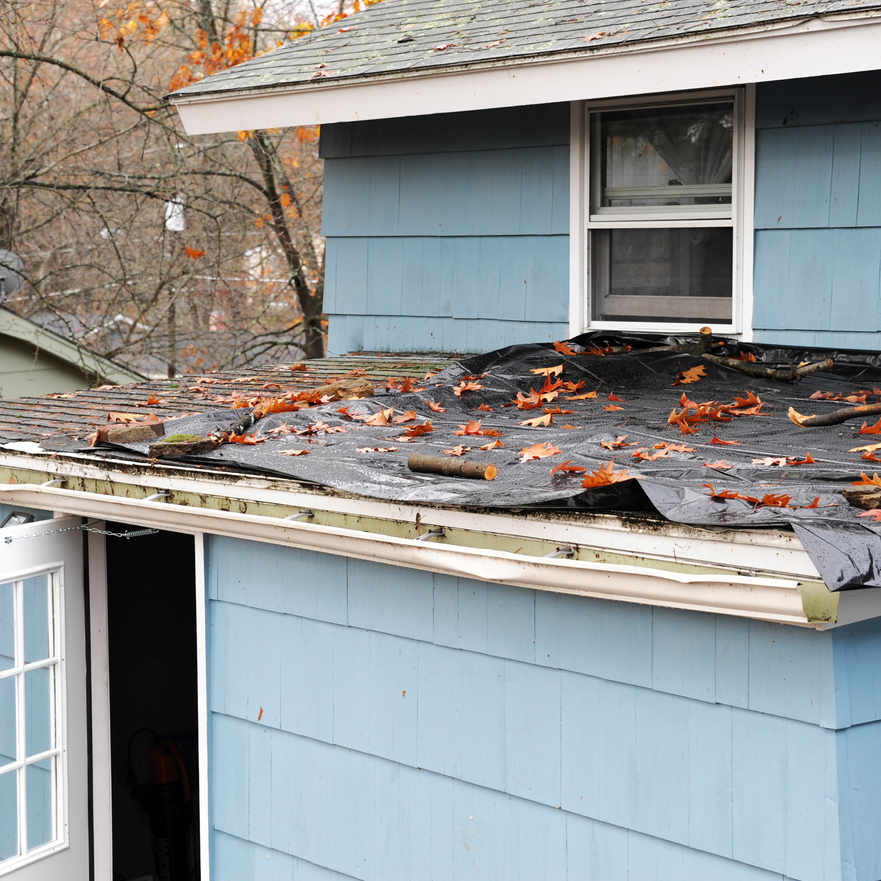 A roof with many of its shingles damaged.